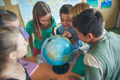 Schoolchildren in a Geography Lesson Royalty Free Stock Image