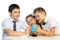 Schoolchildren and the globe Stock Photo