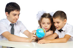 Schoolchildren and the globe Stock Photography