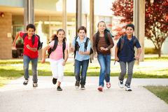 Schoolchildren at home time Stock Photos