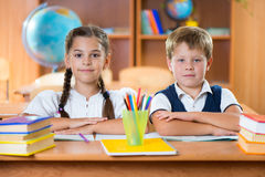 Schoolchildren during lesson in classroom at school. Cute schoolchildren during lesson in classroom at school Royalty Free Stock Images