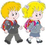 Schoolchildren. Little schoolgirl and schoolboy going with schoolbags Stock Photography
