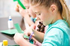 Schoolchildren making applique Stock Photo