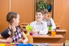 Schoolchildren or pupils at lesson Stock Photography
