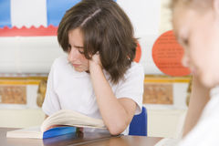 Schoolchildren reading books in class Royalty Free Stock Photo