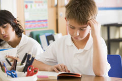 Schoolchildren reading books in class Royalty Free Stock Image