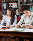 Schoolchildren Reading Books In Library Royalty Free Stock Photo