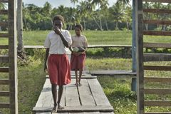 Schoolchildren in scooluniform. Royalty Free Stock Photo