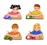 Schoolchildren sitting at their desks Royalty Free Stock Photography