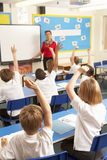 Schoolchildren Studying In Classroom With Teacher Royalty Free Stock Photos