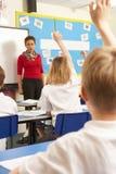 Schoolchildren Studying In Classroom With Teacher Stock Images