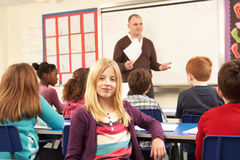 Schoolchildren Studying In Classroom With Teacher Royalty Free Stock Photography