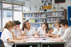 Schoolchildren studying in school library Royalty Free Stock Image
