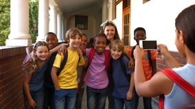 Schoolchildren taking a photo together stock video
