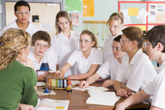Schoolchildren and teacher in science class Royalty Free Stock Image