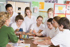 Schoolchildren and teacher in science class Royalty Free Stock Images