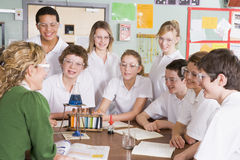 Schoolchildren and teacher in science class Stock Image