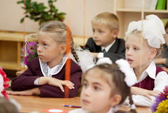 Schoolchildren in their first lesson Royalty Free Stock Images