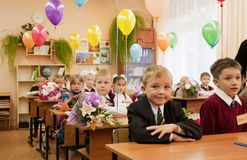 Schoolchildren in their first lesson Stock Photography