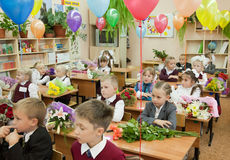 Schoolchildren in their first lesson Stock Image