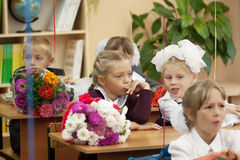 Schoolchildren in their first lesson i Royalty Free Stock Photo