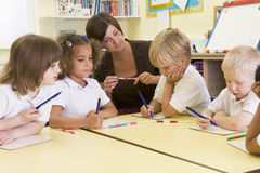 Schoolchildren and their teacher in primary class Royalty Free Stock Photo