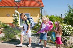 Schoolchildren on their way to school Royalty Free Stock Image
