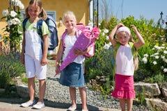 Schoolchildren on their way to school Royalty Free Stock Photos
