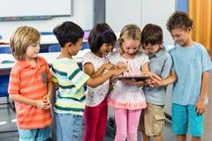 Schoolchildren using digital tablet Stock Photo