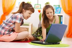 Schoolchildren using internet Stock Photography