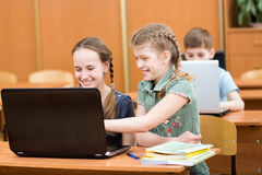 Schoolchildren using laptop at lesson Royalty Free Stock Photography