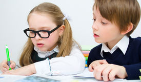 Schoolchildren writing at school Royalty Free Stock Photography