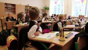 Schoolchilds in classroom stock footage