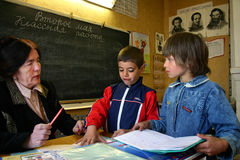 Schoolclass schoolteacher with students. Stock Images