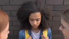 Schoolers communicating, ignoring biracial girl, silent treatment discrimination. Stock footage stock video