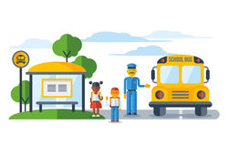 Schoolers getting on yellow schoolbus at bus stop Stock Photo