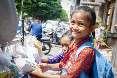 Schoolgifls buying school requisites in Ubud, Bali Royalty Free Stock Photo