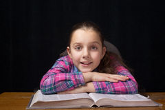 Schoolgir reading royalty free stock photography