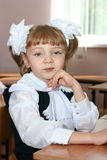 The schoolgirl. Sits at a school desk Stock Photography