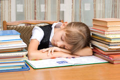 Schoolgirl. The tired schoolgirl has fallen asleep during reading Royalty Free Stock Photo
