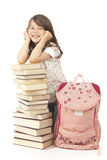 Schoolgirl. With book and school bag on white background Royalty Free Stock Image