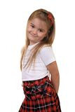 Schoolgirl. Posing in studio in school uniform, white isolated royalty free stock photo