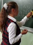 Schoolgirl. The schoolgirl writes the multiplication table at a lesson of mathematics Stock Photography