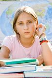 Schoolgirl. A schoolgirl is awaiting of studies beginning Stock Image