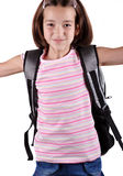 Schoolgirl. Happy young schoolgirl with satchel jump against white background Royalty Free Stock Images