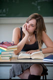 Schoolgirl absorbed in thought Stock Photo