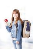 Schoolgirl with apple Stock Photography