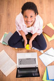 Schoolgirl with an apple Royalty Free Stock Image