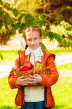 Schoolgirl with apples in autumn Royalty Free Stock Photography