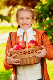 Schoolgirl with apples in autumn Royalty Free Stock Photos